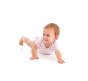 Impish little girl rolling on floor Royalty Free Stock Photography