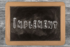 Implement -  chalkboard. Implement - chalkboard with 3D outlined text - on wood Stock Photo