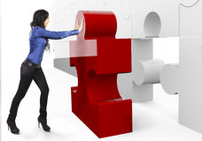 Implementation. Business Teamwork - businesswoman, builds or complets a big puzzle Stock Images
