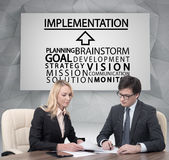 Implementation. Businesspeople working in office, implementation concept Stock Photo