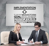 Implementation concept. Businesspeople working in office, implementation concept Stock Photos