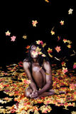 Implied Nude African American Woman Throwing Autumn Leaves Stock Photo
