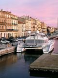 Imponing Luxury white yacht on a canal of Sète in France early in the morning. royalty free stock photo
