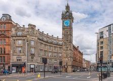 Imponująco architektura stara Tollbooth zegaru i Steeple głowna ulica Glasgow fotografia stock