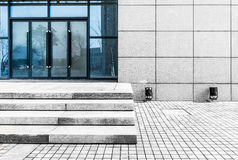The import and export of office building. Glass door step marble pavement background Royalty Free Stock Images