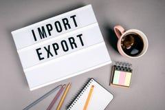 Import och export Text i ljus ask royaltyfri foto