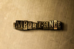 IMPORTANCE - close-up of grungy vintage typeset word on metal backdrop Stock Image