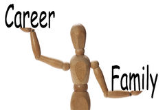 Importance of family versus the career. Mannequin measuring the importance of family versus the career on the palms of the hands stock image