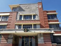 Facade of the main entrance of vthe primary school Miguel Alemán in Toluca, Mexico. In important avenue Isidro Fabela, against the reform garden, well known Stock Photos