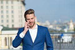 Important business call. Businessman happy smiling use smartphone for business communication, skyline background. Man. Use business call modern approach make Stock Image
