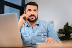 Nice bearded man speaking on the phone Royalty Free Stock Photos