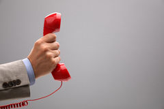 Important call. Red phone over gray background concept for customer support line or important call royalty free stock photos