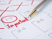 Important date on calendar desk 2. Close up handwriting word important and pen on calendar desk 1 Selective focus stock photography