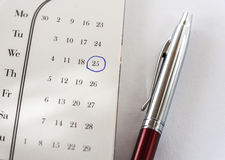 Important Date On Calendar and Pen. On White Background Close-Up Stock Photography