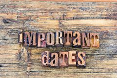 Important dates sign letterpress. Important dates list message sign letterpress barn wood block words background typography calendar schedule stock photo