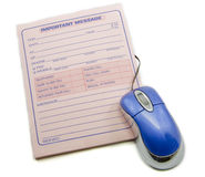 Important message memo pad and computer mouse Royalty Free Stock Photos
