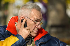 Important news, senior phoning, close up Stock Image