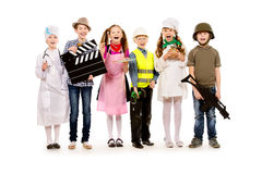 Important profession. A group of children dressed in costumes of different professions. Isolated over white Royalty Free Stock Photo