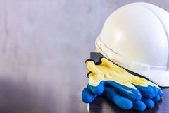 Important surveying on the construction site the foreman. White helmet, gloves, and drawings are on the table stock photography