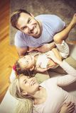 It is important that we are together. Young family at home. Close up. Looking at camera stock photo