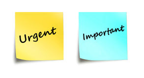 Important and urgent words on stick notes Royalty Free Stock Photo