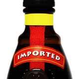 Imported Alcohol. Imported liqueur bottle on a white background with clipping path Royalty Free Stock Images