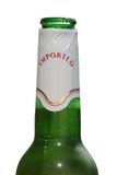 Imported beer. Green beer bottle with sticker isolated against a white background. (This image contains a clipping path royalty free stock image