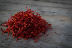 Imported Persian Saffron on a wooden table Stock Photography