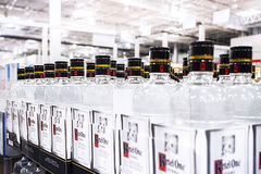 Imported Vodkas Line Up on Shelves Stock Photo
