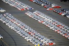 Imported Volkswagen Beetle automobiles in a parking lot in Boston, Massachusetts Stock Image