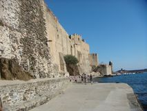 Imposing ancient boundaries and a castle of the city of Colluire on the sea in the oriental pyrennes in south of France. Imposing ancient boundaries. City on the Royalty Free Stock Photo