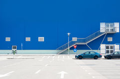 Imposing blue hall. With a parking lot Stock Image