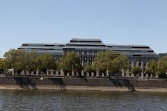 An imposing building at the river bank of the rhine in cologne germany. Photographed in wide angle lens stock images