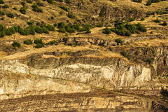 Imposing layers of mountain rock cliffs. Imposing layers of yellow mountain rock cliffs royalty free stock photo