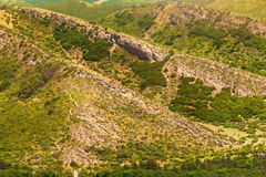 Imposing layers of yellow mountain rock cliffs Royalty Free Stock Image