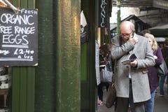 Imposing man talking on the phone at Borough Market Stock Photo