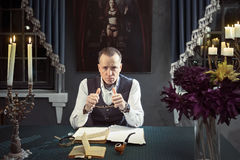 Imposing man is working creatively at the table Stock Images