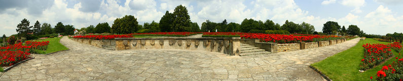 Imposing memorial panorama. An extensive monumental war memorial - rose garden part royalty free stock photo