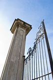 Imposing old gate column. Wide angle from below on blue sky Royalty Free Stock Images