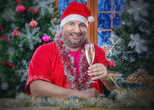 Imposing Santa Claus toasting on New Year Eve Royalty Free Stock Photography