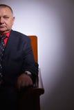 Imposing senior businessman in office Stock Photo