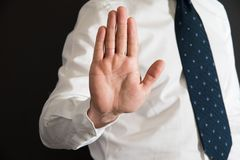 Imposing stop with gesture of a hand. Man imposing stop with gesture of a hand Stock Photography