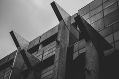 Imposing and threatening building in black and white. Imposing and threatening building in black and white looking like an evil mastermind`s headquarters Royalty Free Stock Photography