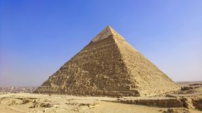 Pyramid of Khafre under blue skies with Cairo in distance at Giza, Egypt stock photo