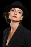 Imposing woman in a hat Royalty Free Stock Image