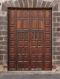 Imposing wooden doors entry Stock Image
