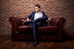 Imposing young man. Imposing well dressed man in a luxurious apartments with classic interior. Luxury. Men`s beauty, fashion Stock Photo