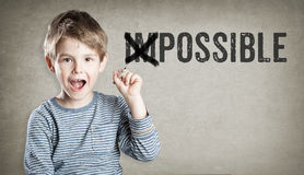 Imposisble, possible, Boy on grunge background writing Stock Photography