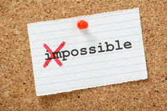 Impossible Becomes Possible. The word Impossible changed to possible by crossing out the first part of the word. A concept for change against the odds or in the Royalty Free Stock Image