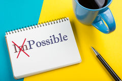 Impossible change transformed into Possible written on notebook page Royalty Free Stock Photos